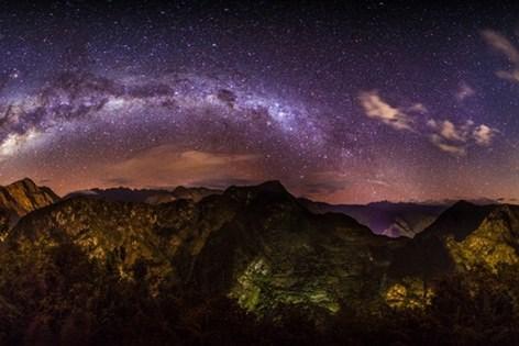 The Milky Way Putucusi Mountain in Peru.jpg
